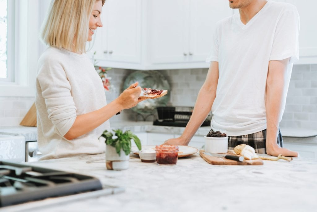 couple eating breakfast in newly renovated kitchen