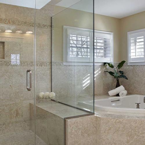 Frameless Glass, brown tile, drop in tub, shower caddy, deco strip, corner tub