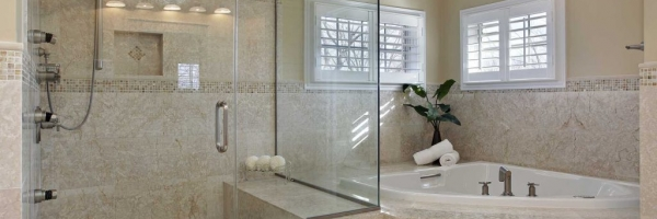 Frameless Glass, brown tile, drop in tub, shower caddy, deco strip, corner tub
