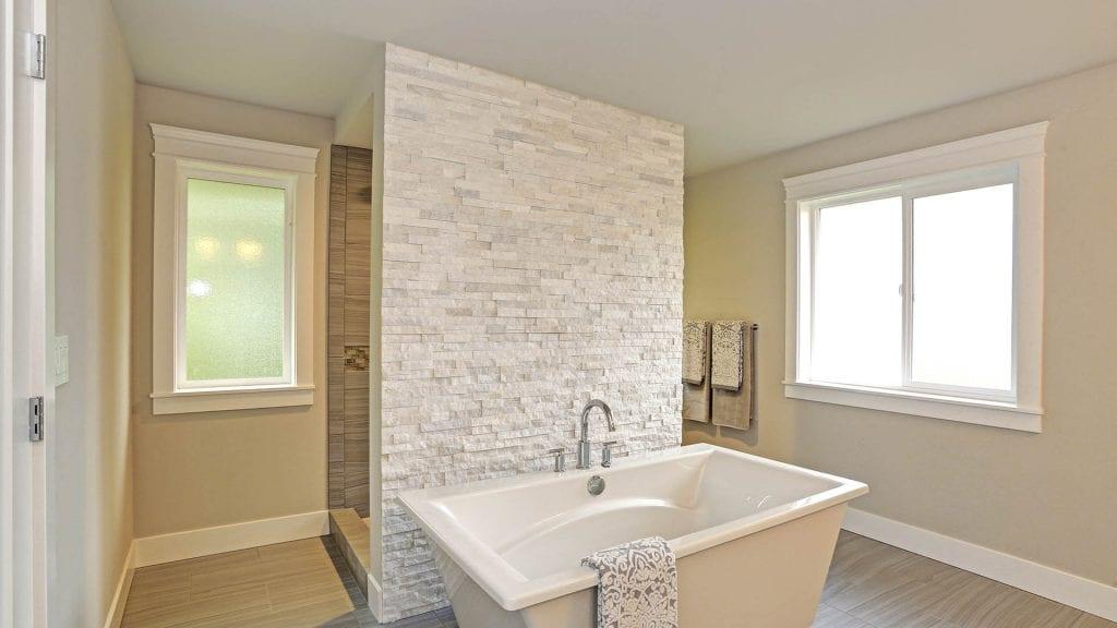 Pedestal tub, stone, tan paint rim mounted freestanding tub faucet