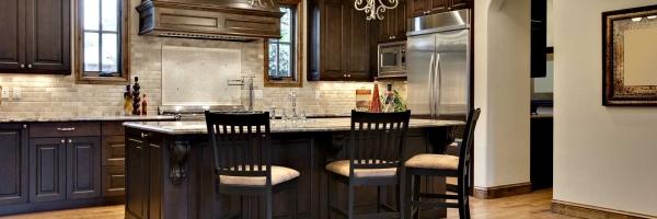 Hardwood Floor, dark brown cabinets, mocha cabinets, arch doorway, wood cabinet hood, raised panel doors stone backsplash
