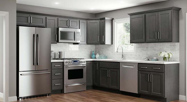 standard overlay cabinet shaker, stainless appliances, subway tile backsplash, slate cabinets, LVP flooring, quartz countertops