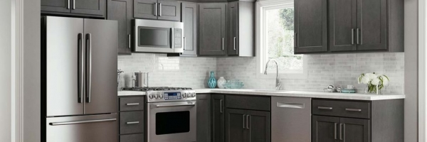 standard overlay cabinet shaker, stainless appliances, subway tile backsplash, slate cabinets, LVP flooring, quartz countertops