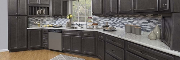 standard overlay cabinet shaker, stainless appliances, tile backsplash, slate cabinets, LVP flooring, quartz countertops