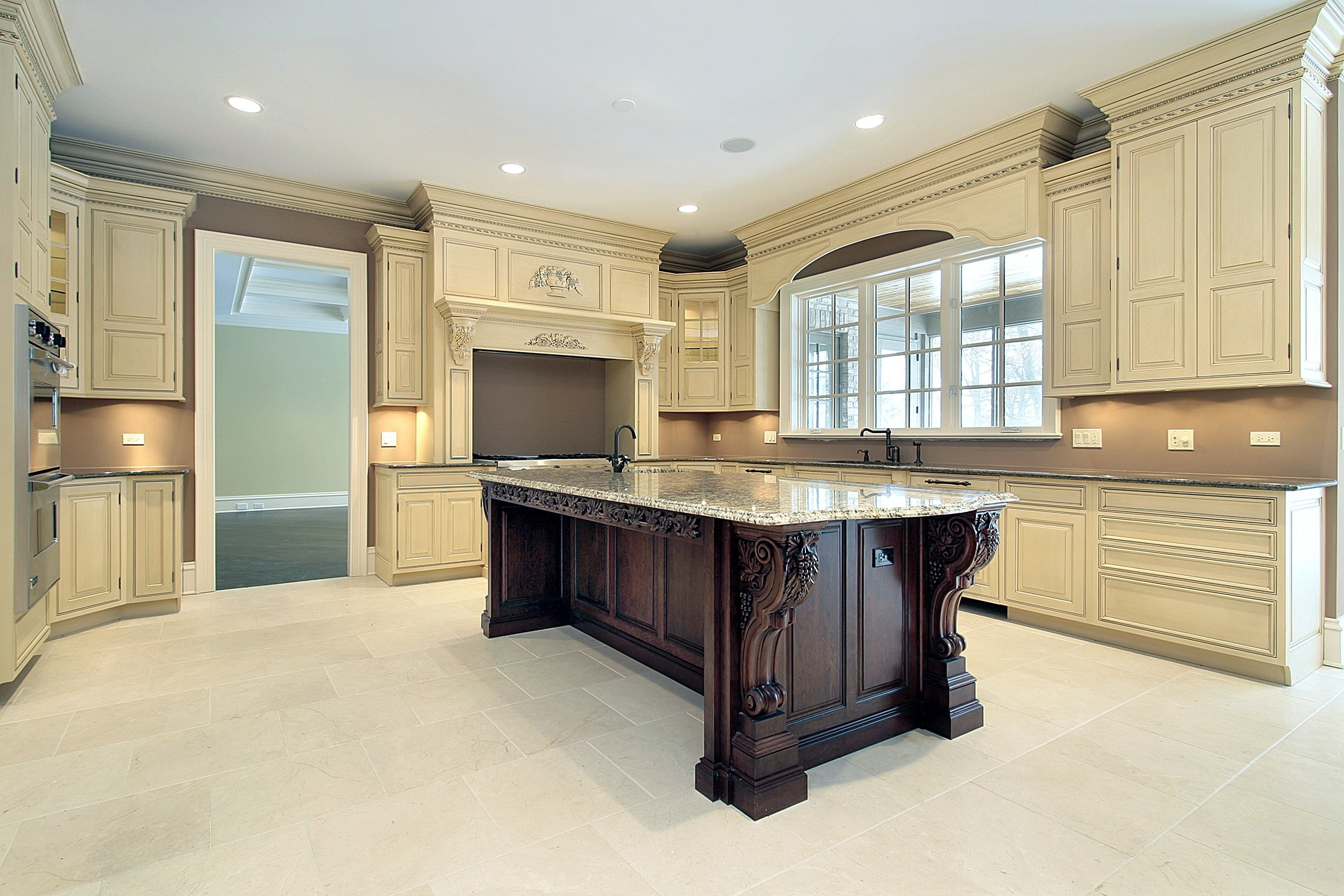 limitless remodeled kitchen with island off white cabinents